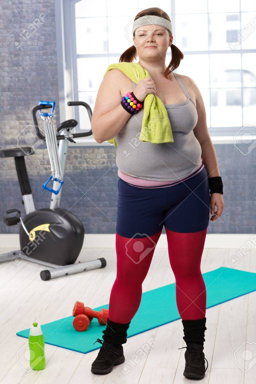 Plump young woman at the gym, prepared for doing gymnastics. Stock Photo - 12472251