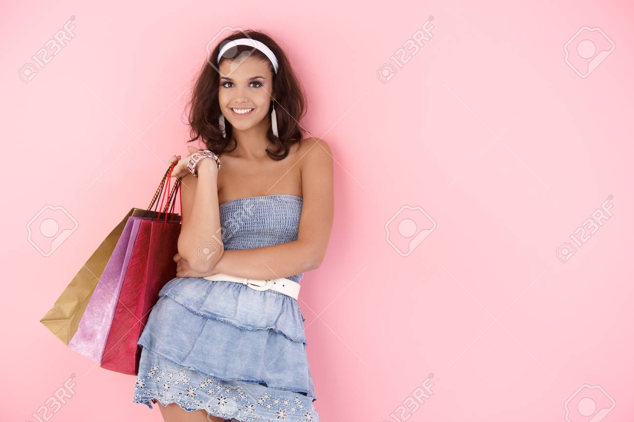 Attractive girl smiling with shopping bags at summertime. Stock Photo - 12652686