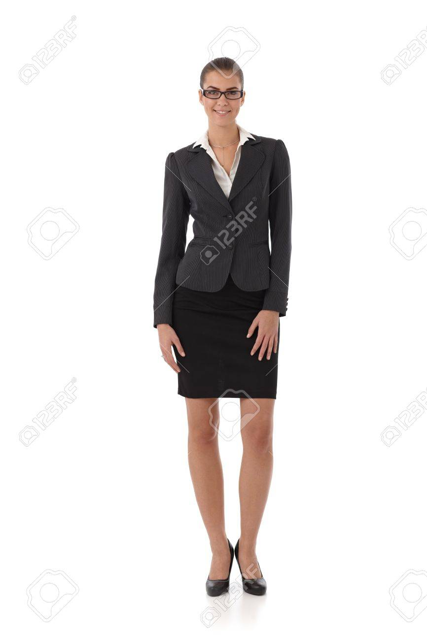 Pretty businesswoman smiling, full size portrait, cutout on white. Stock Photo - 13098508