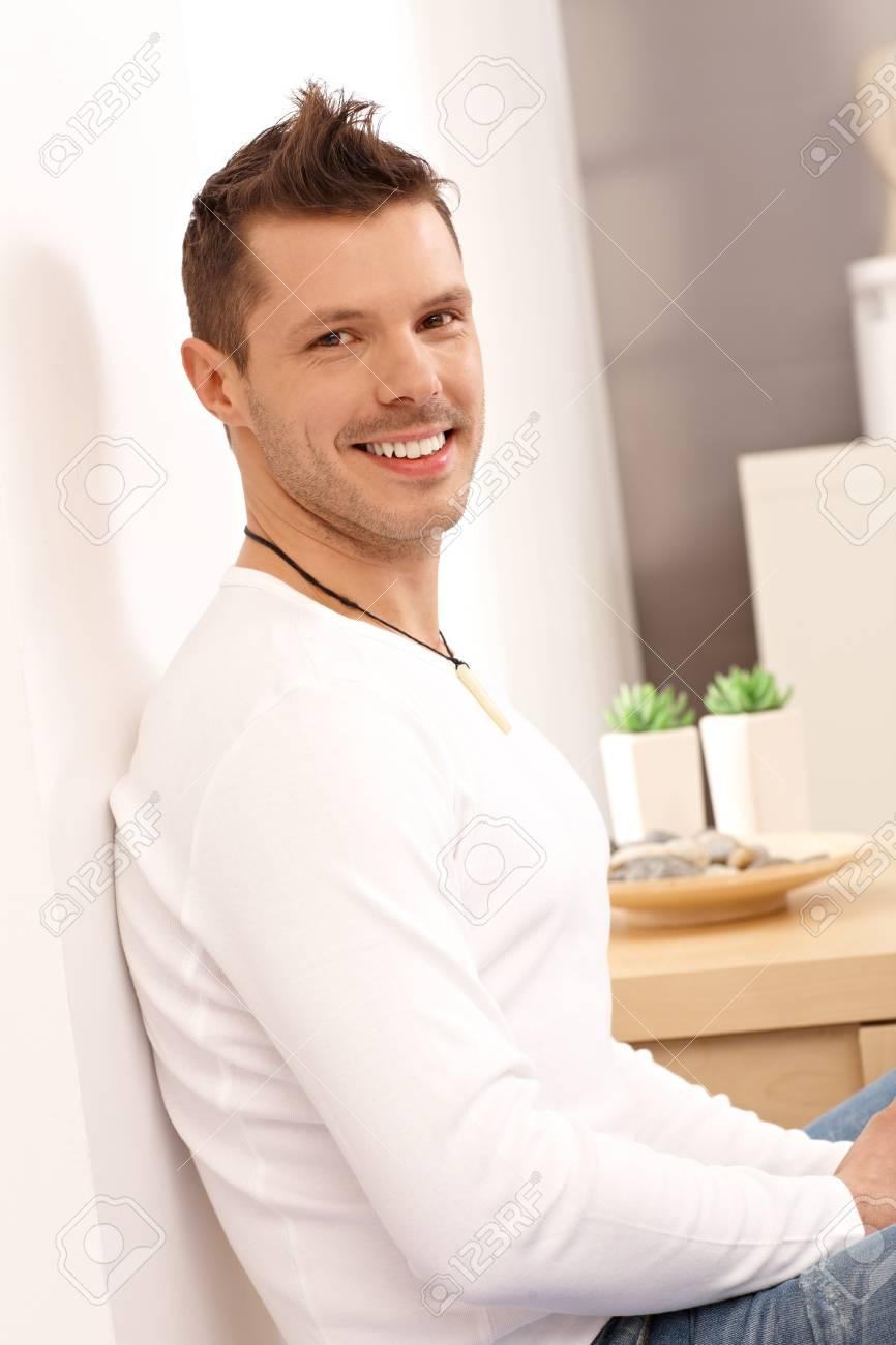 Happy young man smiling at home, looking at camera. Stock Photo - 13964709