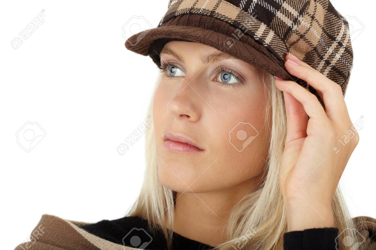 Closeup portrait of beautiful girl posing with winter hat. Stock Photo - 14314251