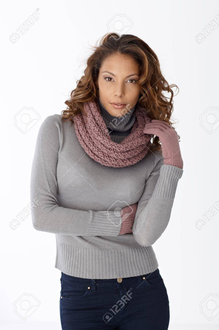 Portrait of pretty casual woman in scarf and gloves over white background. Stock Photo - 14314273