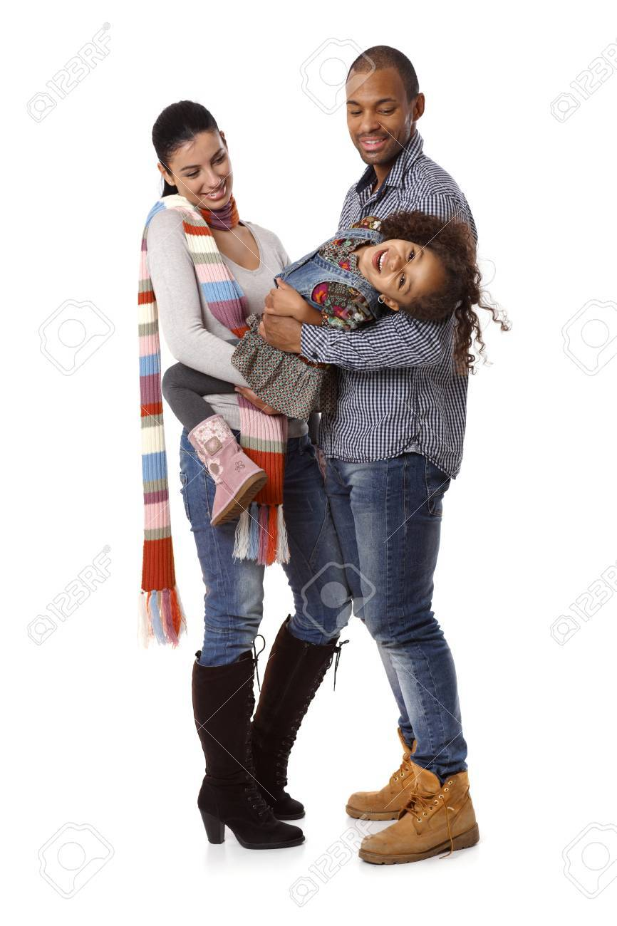 Happy interracial family with little daughter laughing. Stock Photo - 14427479