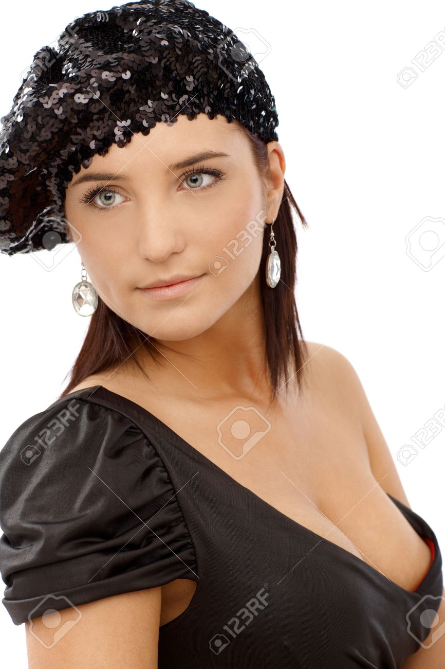 5e9cf69562ef Portrait of sexy woman in black party dress with hot cleavage and sequin  hat, looking