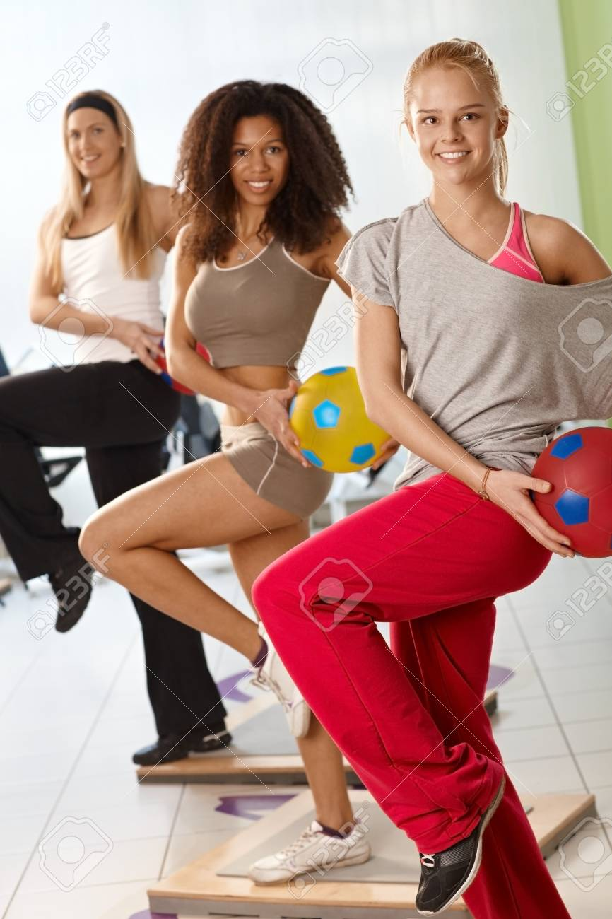 Happy young women exercising with ball at the gym. Stock Photo - 14746101
