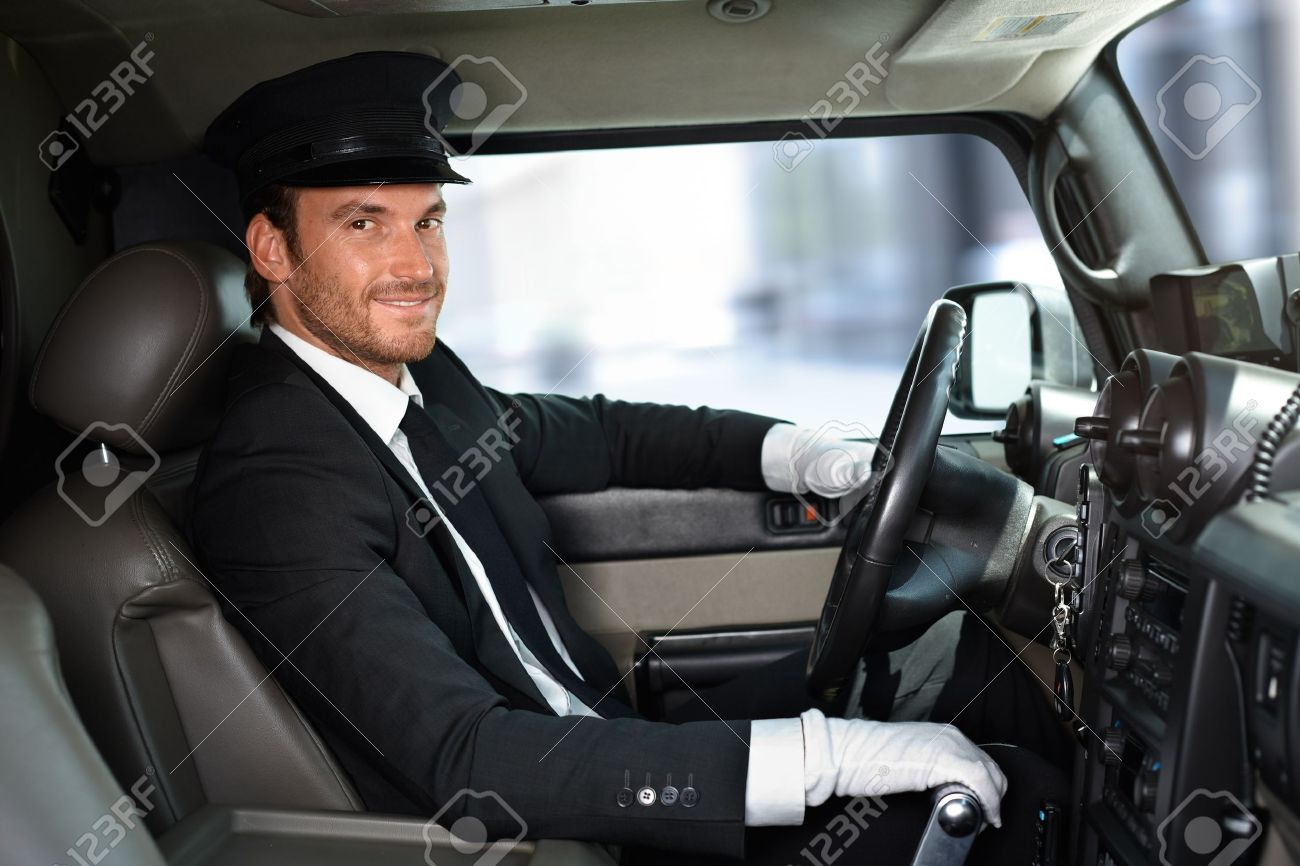 handsome smiling chauffeur driving limousine stock photo 14767436