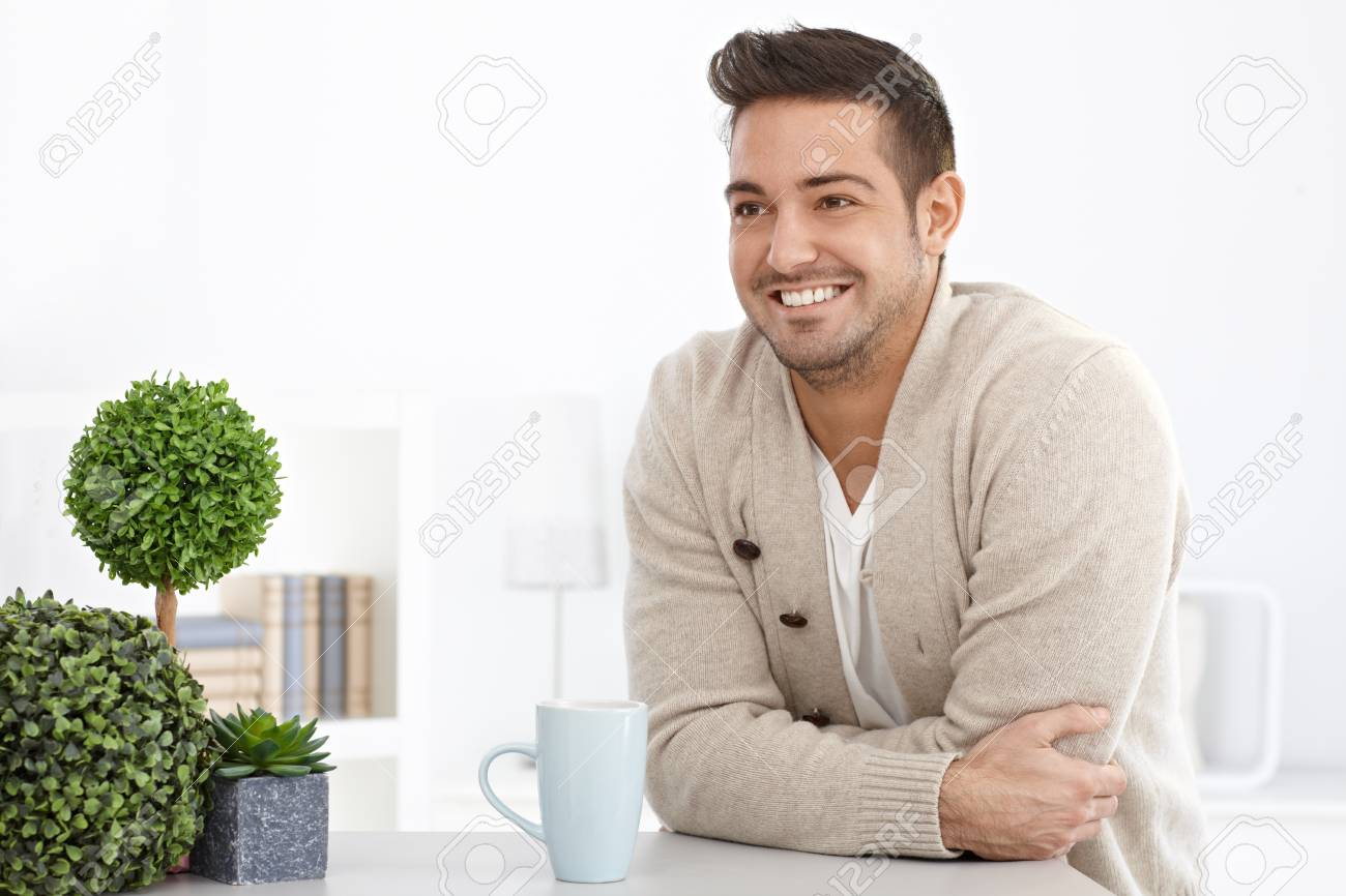 Happy young man smiling at home, looking away. Stock Photo - 15032920