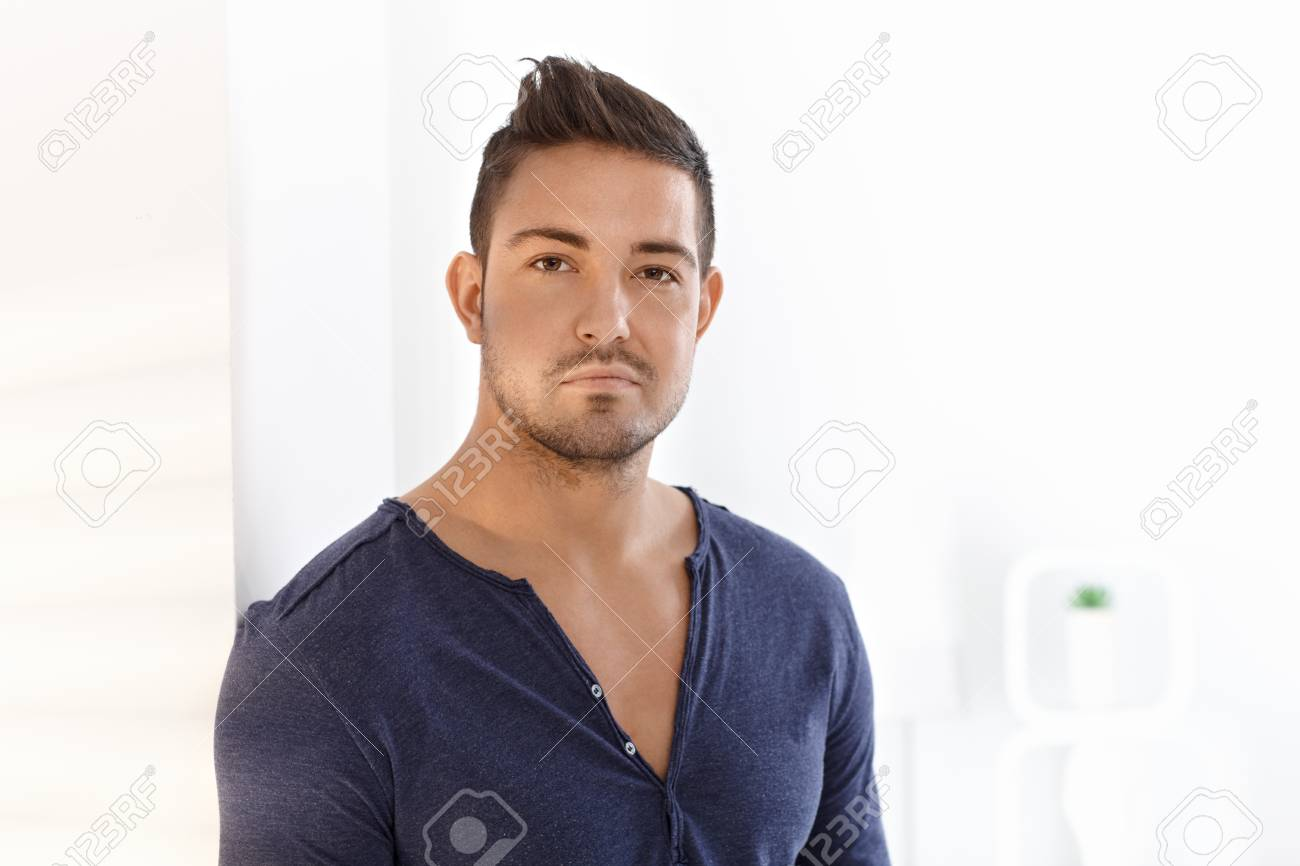 Portrait of serious looking young man. Stock Photo - 15032818