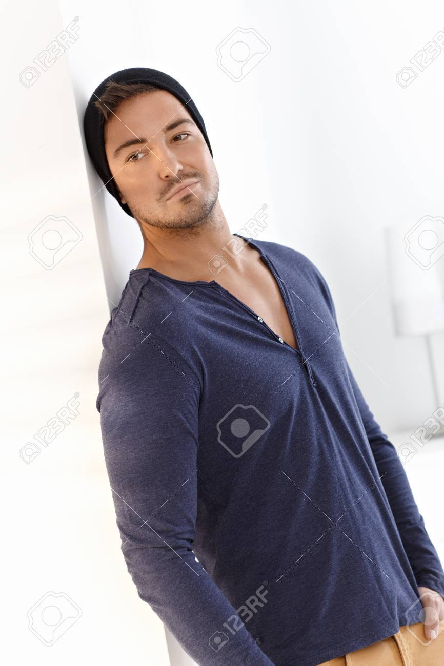Handsome man daydreaming at home in cap. Stock Photo - 15032939