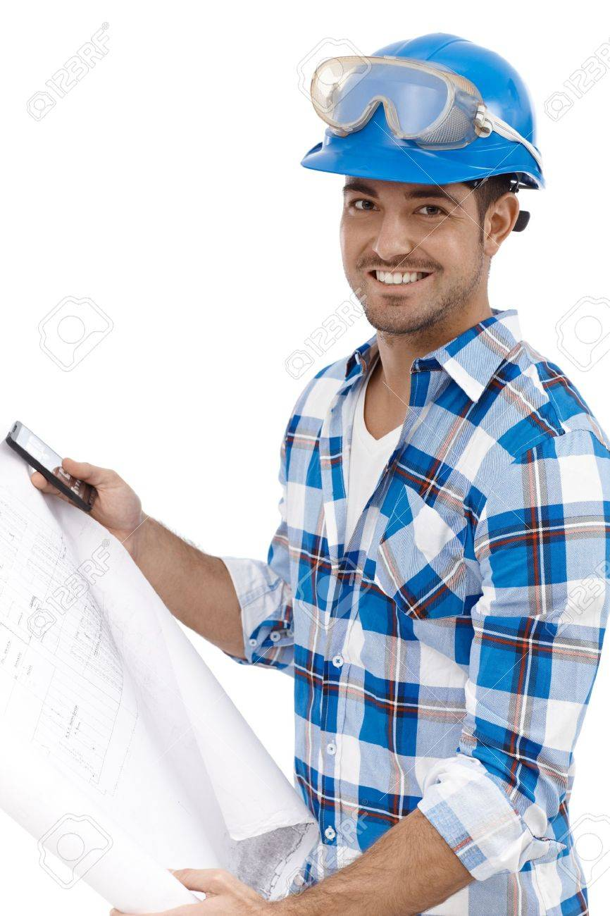 Young architect holding floor plan smiling. Stock Photo - 15032921