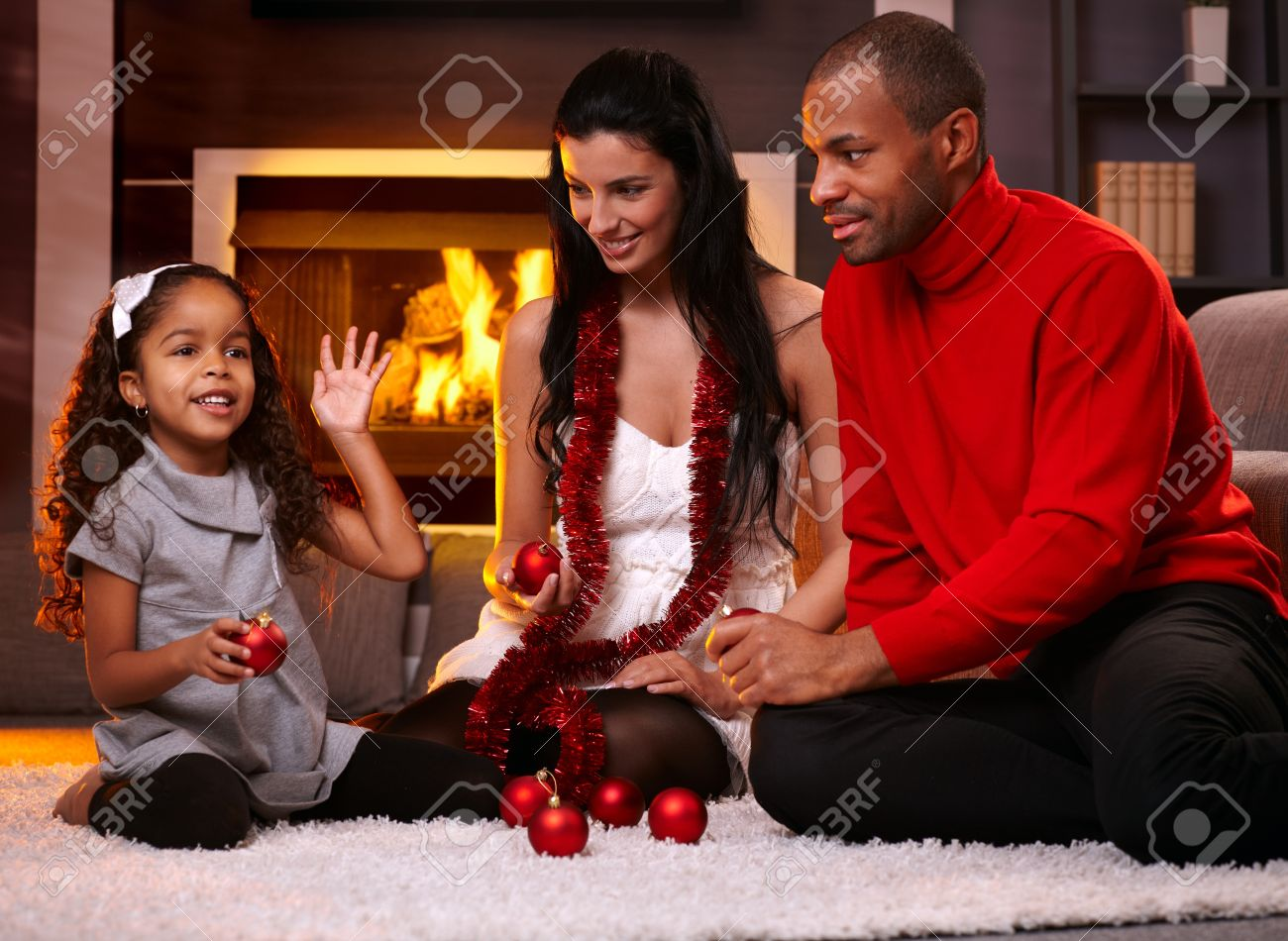 Beautiful diverse family at home in christmas time, sorting christmas decorations. Stock Photo - 15287027