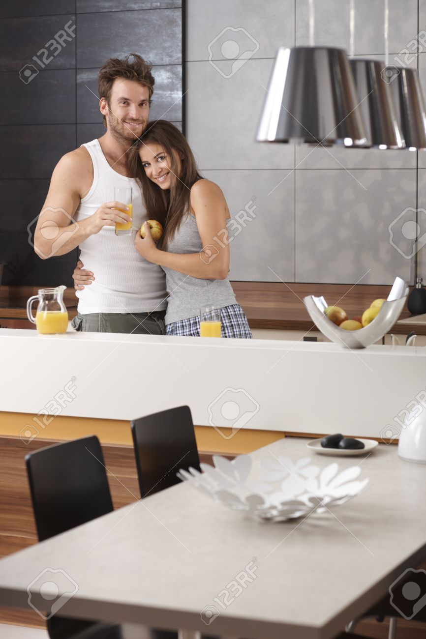 Portrait of happy loving couple in the morning at the kitchen. Stock Photo - 17098471