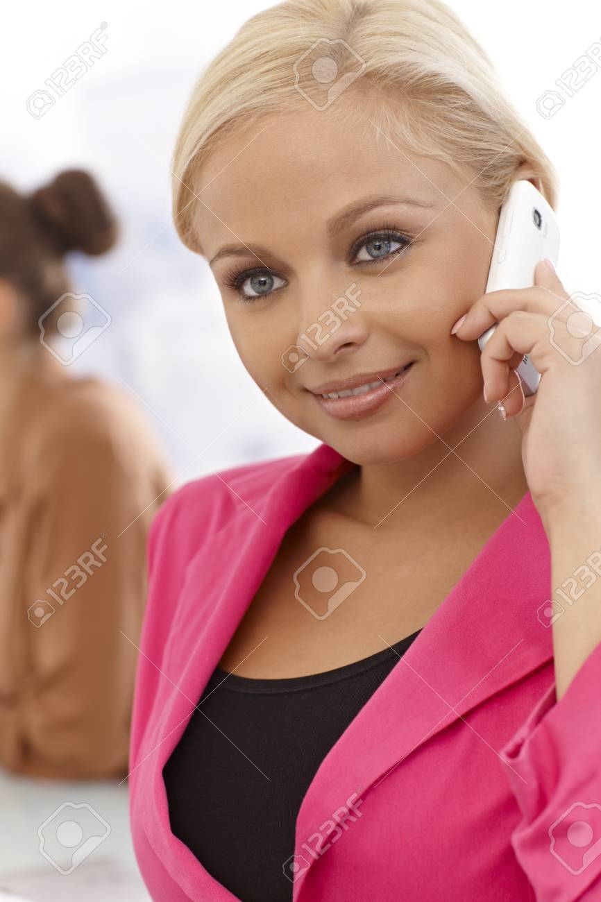Closeup portrait of attractive young businesswoman talking on cellphone, smiling. Stock Photo - 17134055