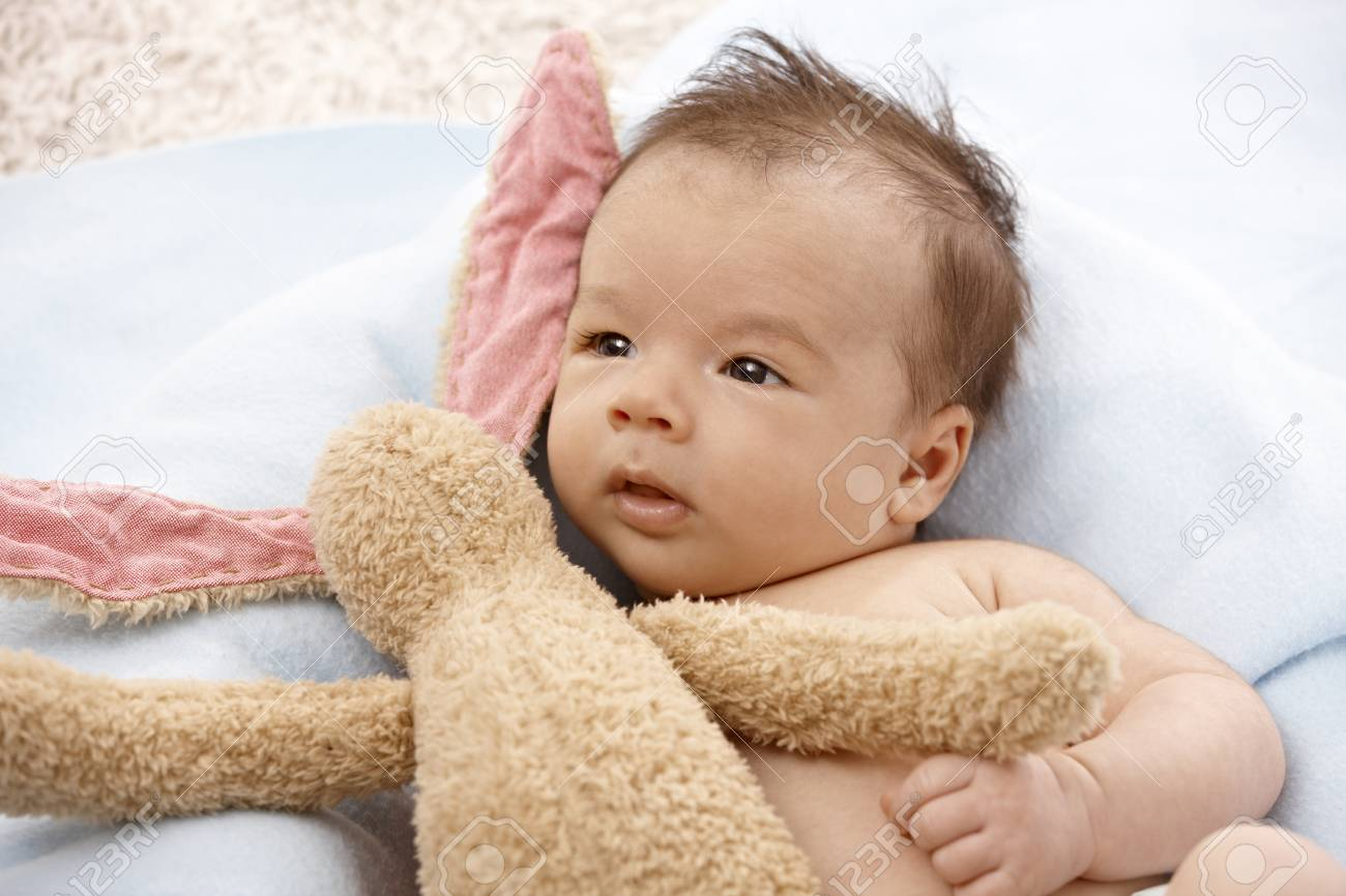 Adorable newborn baby with plush bunny. Stock Photo - 17159649