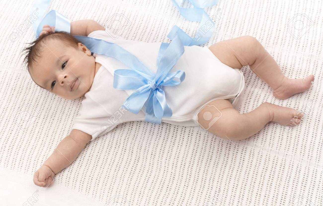 Infant baby boy in white bodysuit and blue ribbon. Stock Photo - 17159656