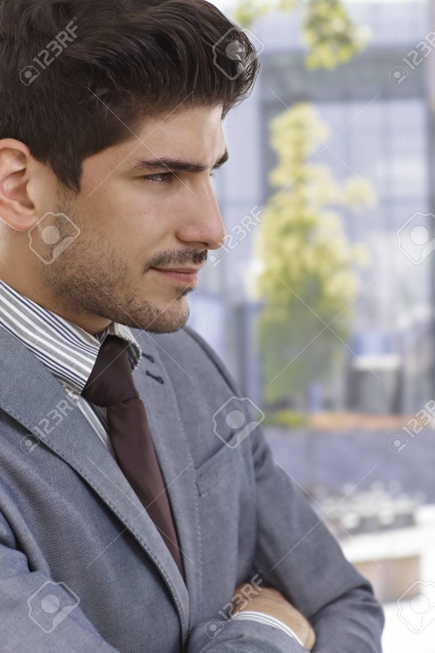 Profile of confident young elegant businessman smiling. Stock Photo - 17420409