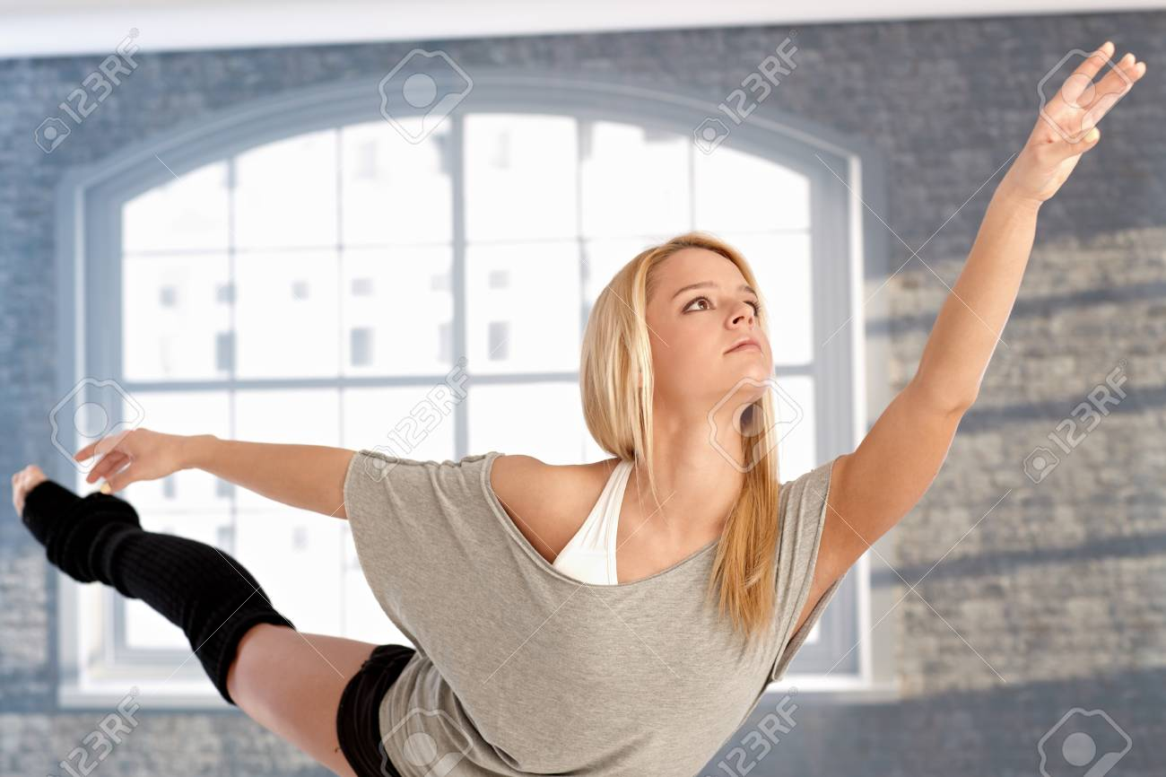 Young female dancer practicing front of window. Stock Photo - 17505843