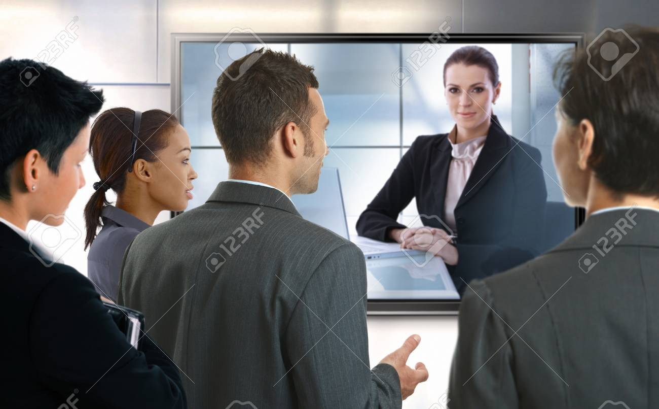 Young businesspeople and businesswoman having video call at office. LCD display. Stock Photo - 22072799