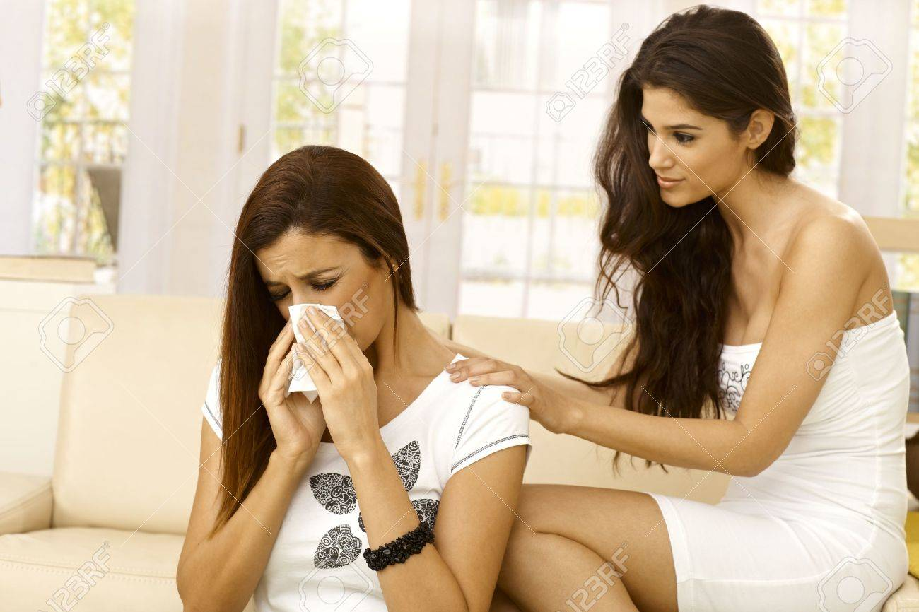 Young woman consoling crying friend at home. Stock Photo - 22283884