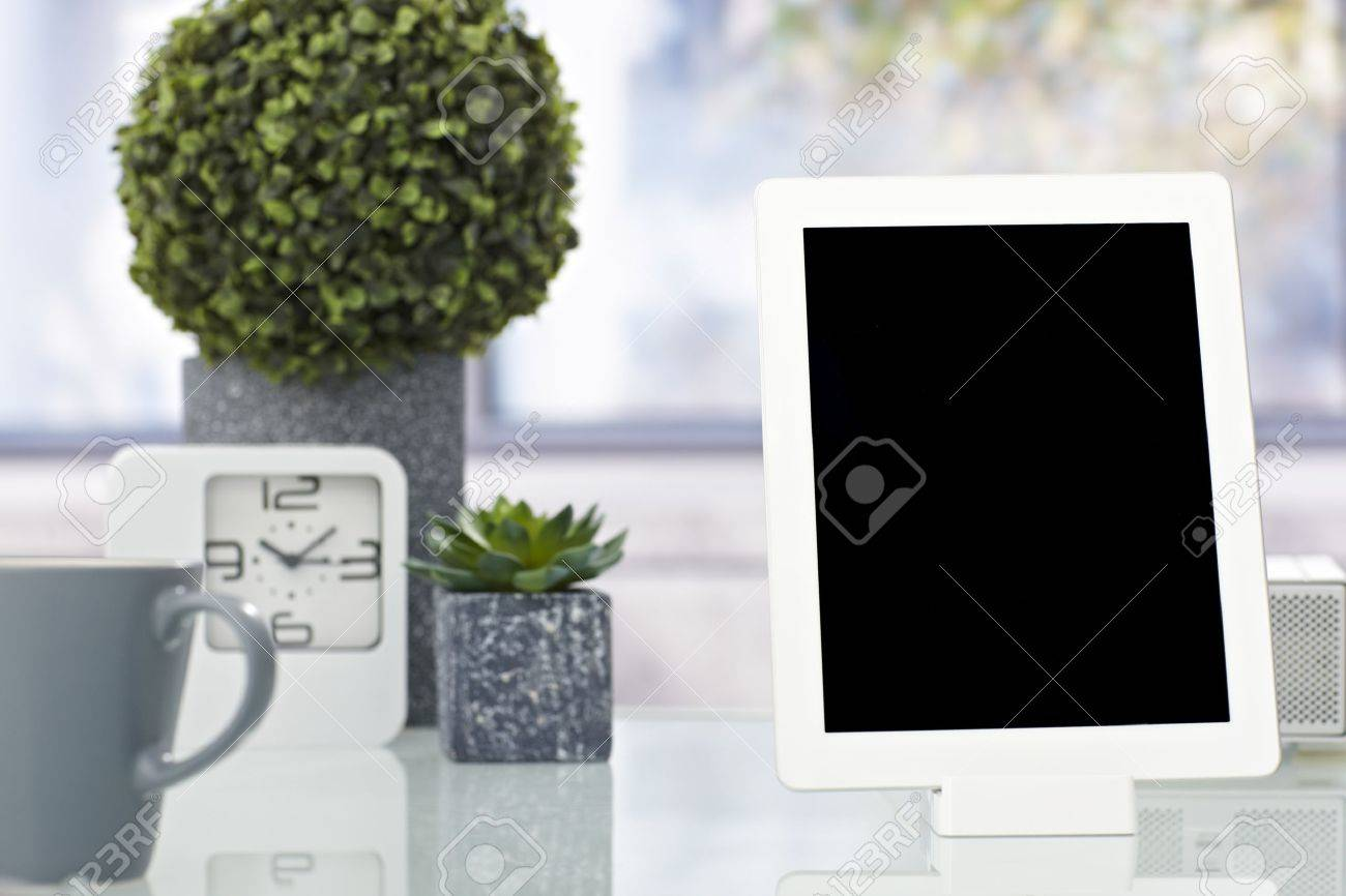 Closeup photo of tablet computer placed on tidy desktop. Stock Photo - 22601797