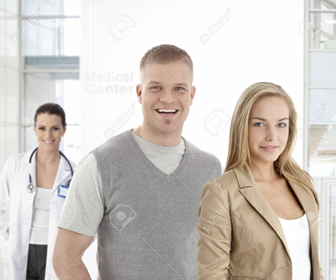 Young couple standing at medical center, smiling, looking at camera. Stock Photo - 22854282