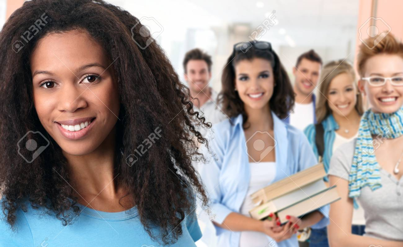 Group of happy students on school corridor looking at camera, smiling. Stock Photo - 25608844