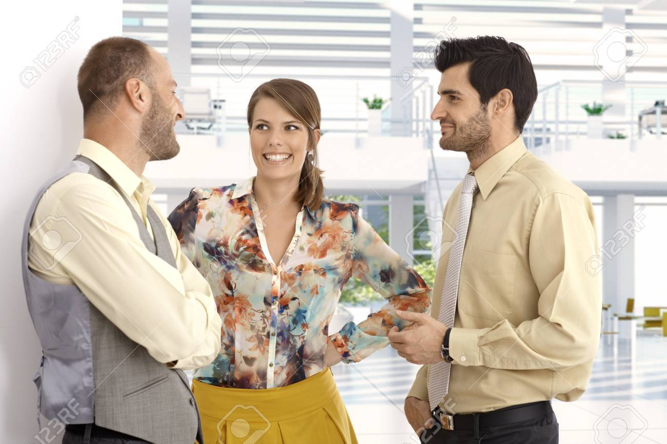 Happy caucasian business people chatting at high tech bright office lobby. Suit, no jacket, smiling, Stock Photo - 26996215