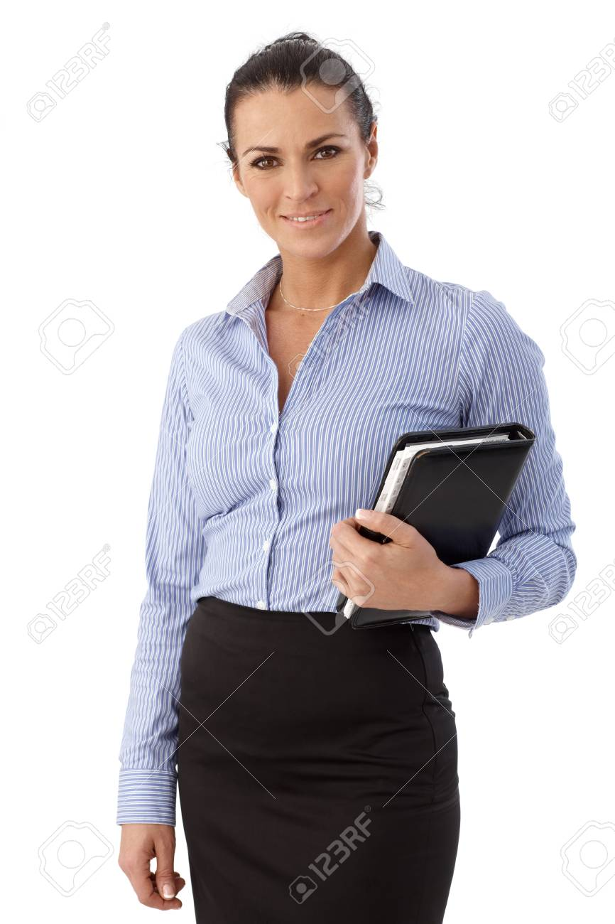 Portrait of happy casual brunette caucasian businesswoman standing in front of white background. Smiling, personal organizer in hand, looking at camera. Stock Photo - 28345594
