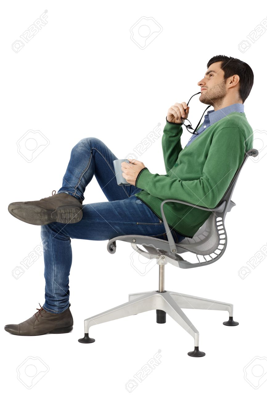 Man sitting in chair side - Side View Of Daydreaming Young Man Sitting In Swivel Chair Stock Photo 33797524