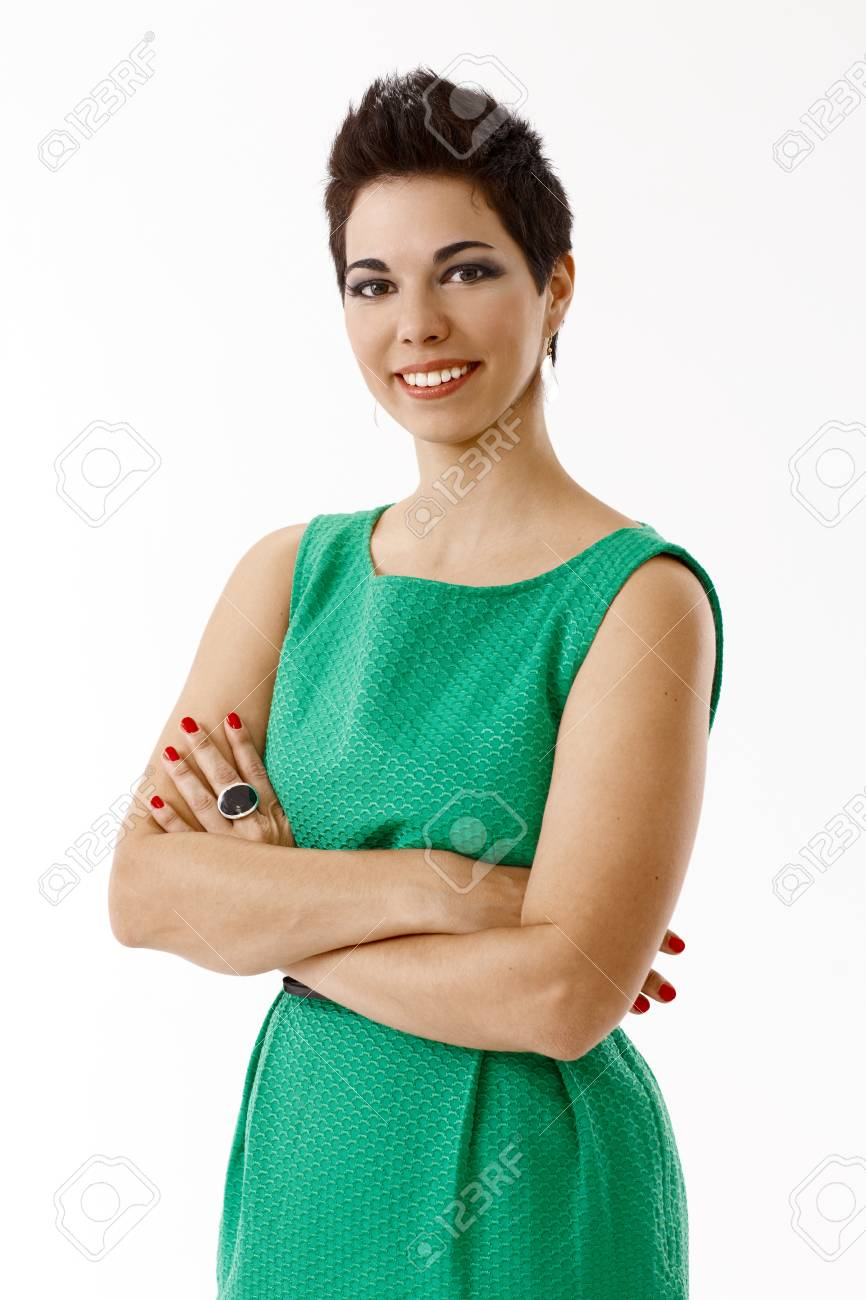 Happy young businesswoman in green dress isolated on white. - 93840536