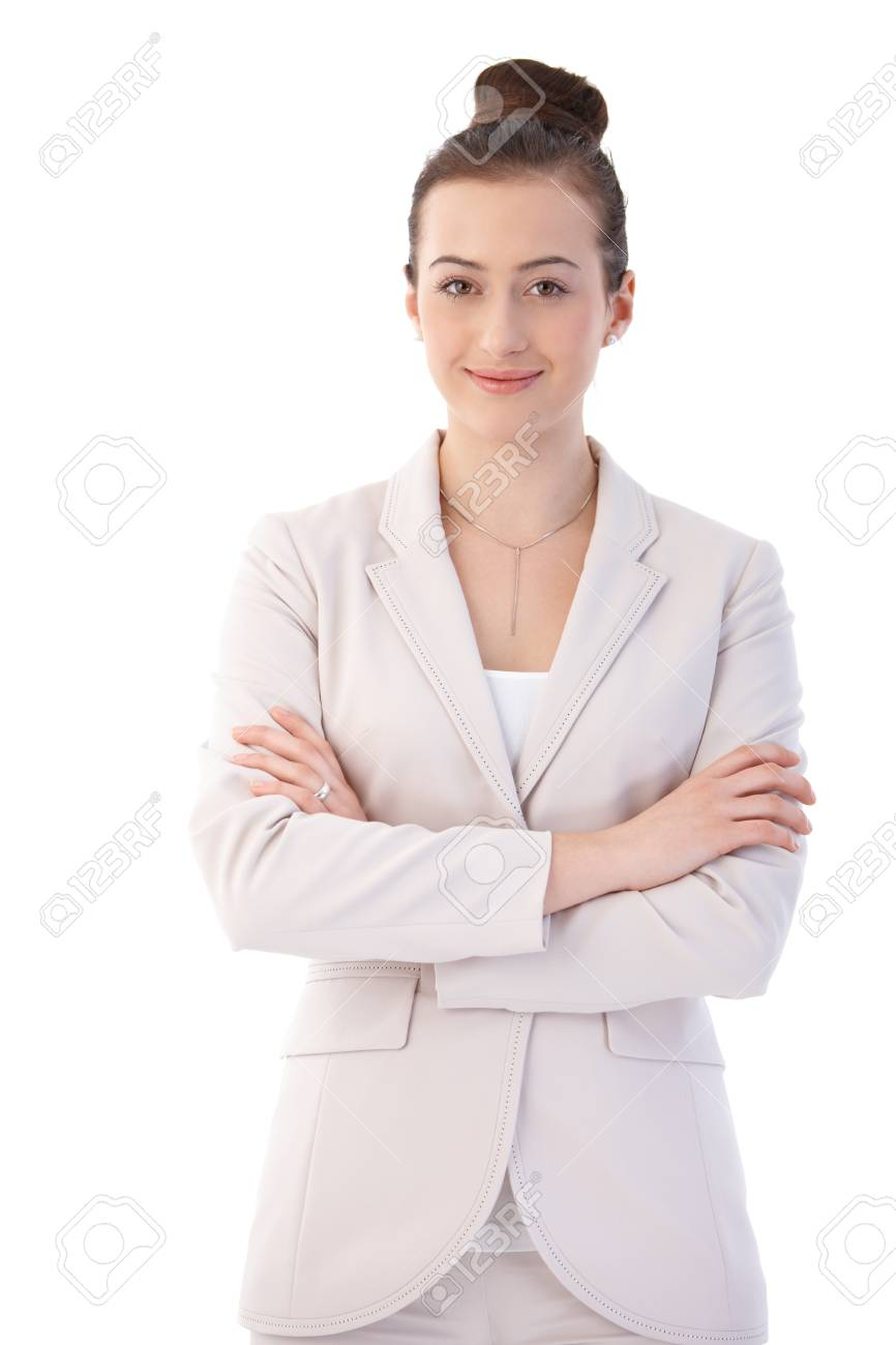 Happy young businesswoman posing in elegant clothes, looking at camera, smiling. Isolated on white. - 125785044