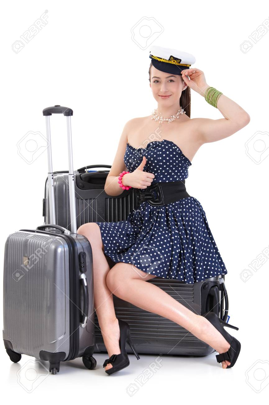 Young woman traveling to vacation with suitcase in summer dress, posing, looking at camera, smiling. Isolated on white. - 125785003