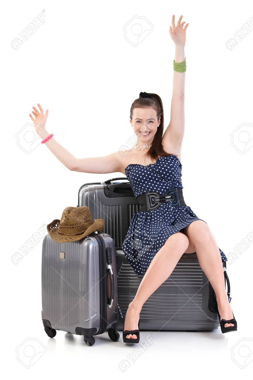 Young woman traveling to vacation with suitcase in summer dress, posing, looking at camera, smiling. Isolated on white. - 125785020