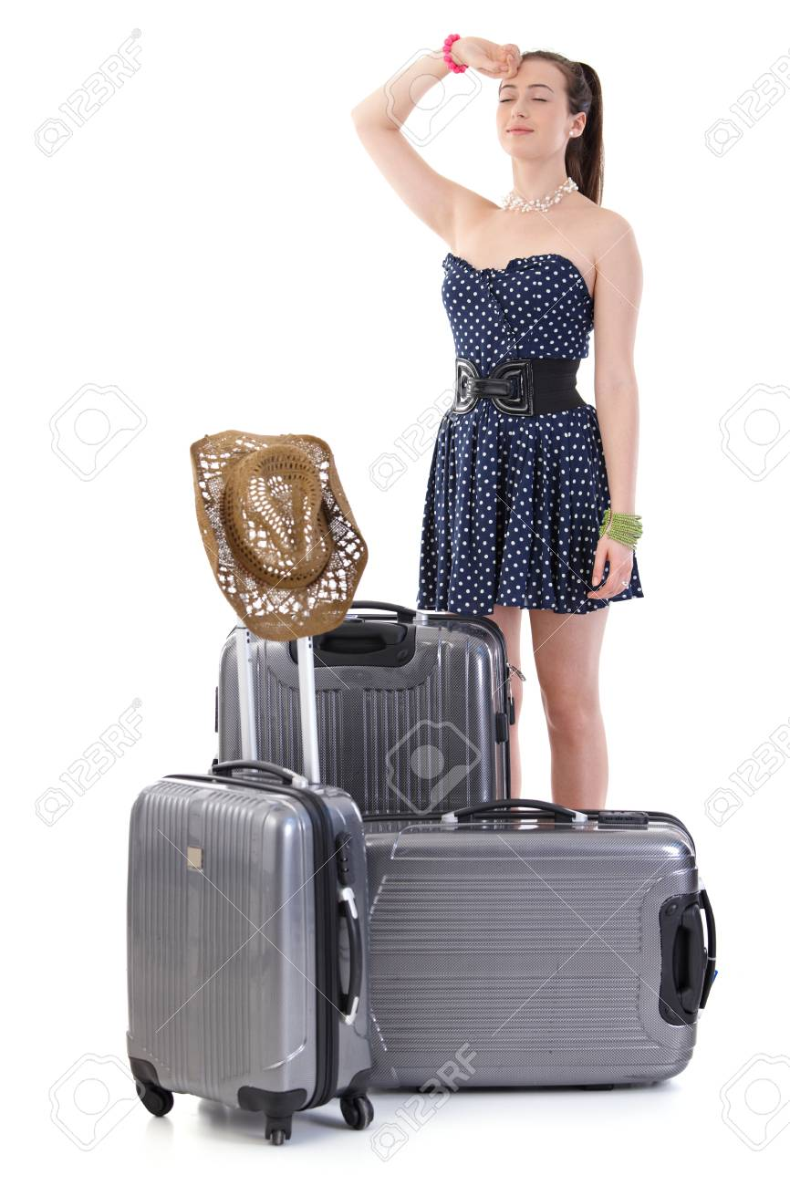 Young woman traveling to vacation with suitcase in summer dress, posing, looking at camera, smiling. Isolated on white. - 125784861