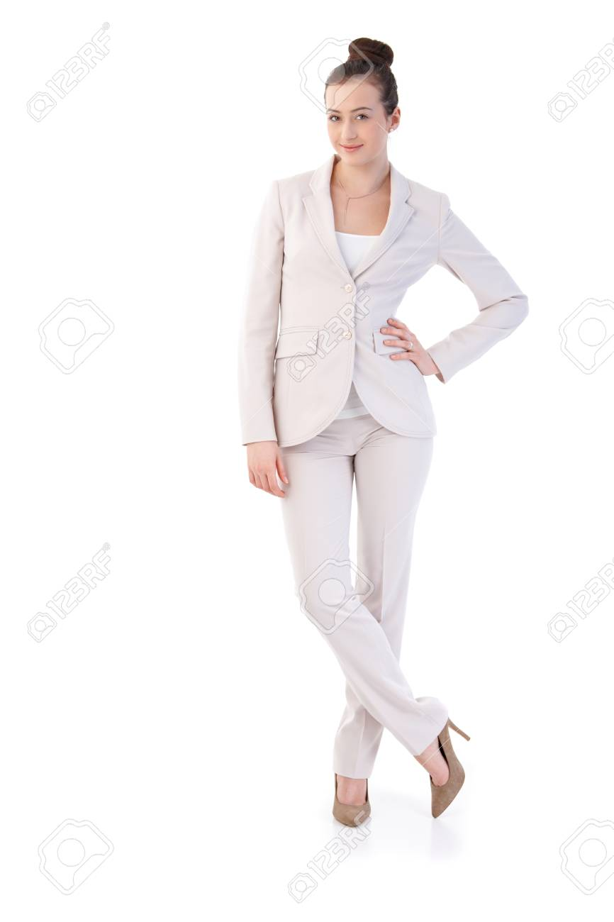 Happy young businesswoman posing in elegant clothes, looking at camera, smiling. Isolated on white. - 125784864