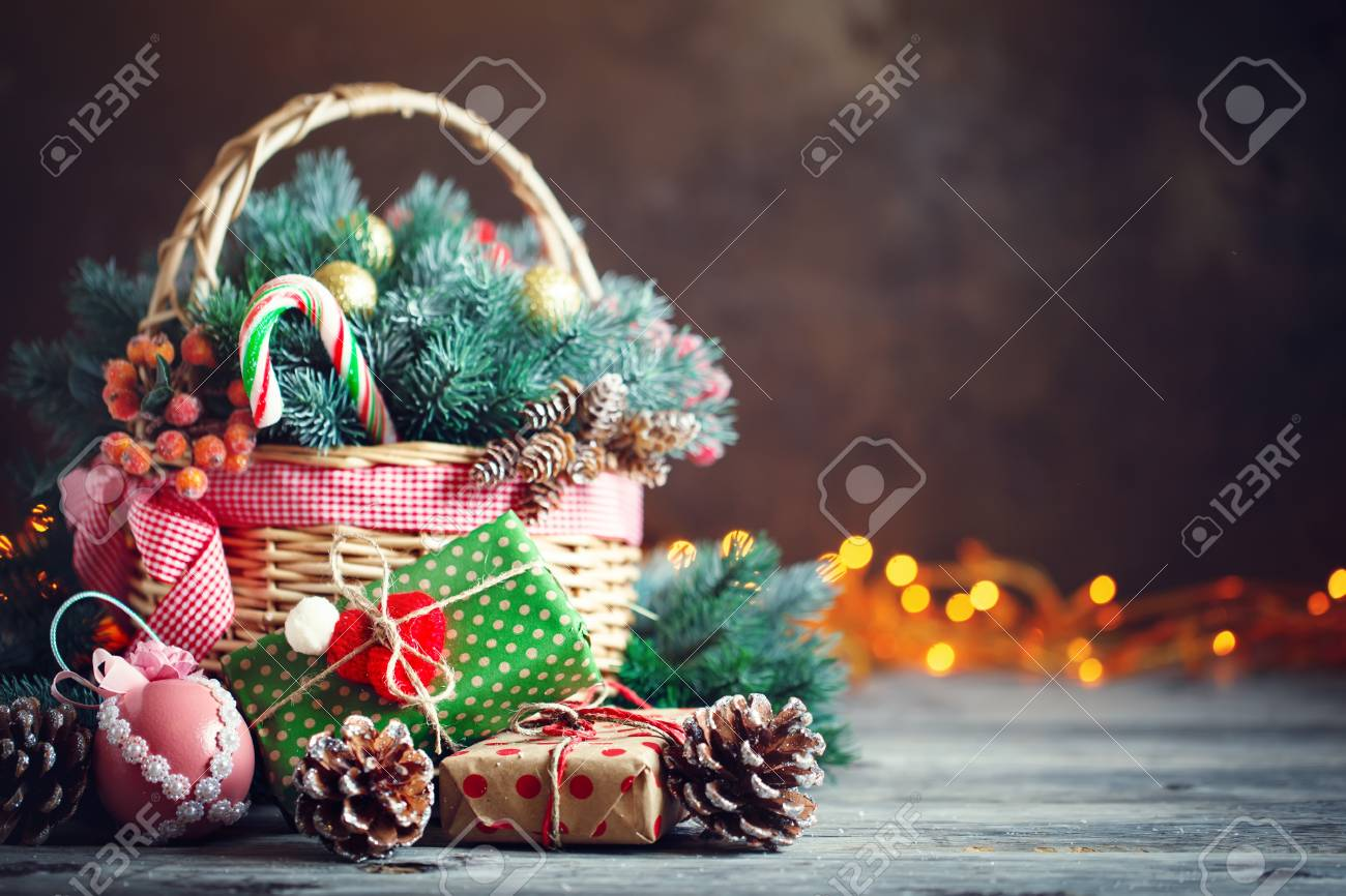 merry christmas and happy new year basket with christmas toys and