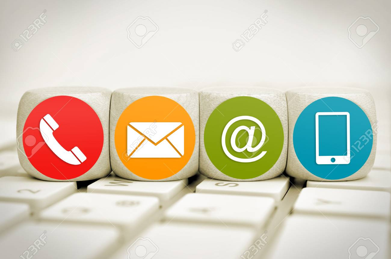 Website aWebsite and Internet contact us page concept with colored icons on cubes on a keyboard - 101535108