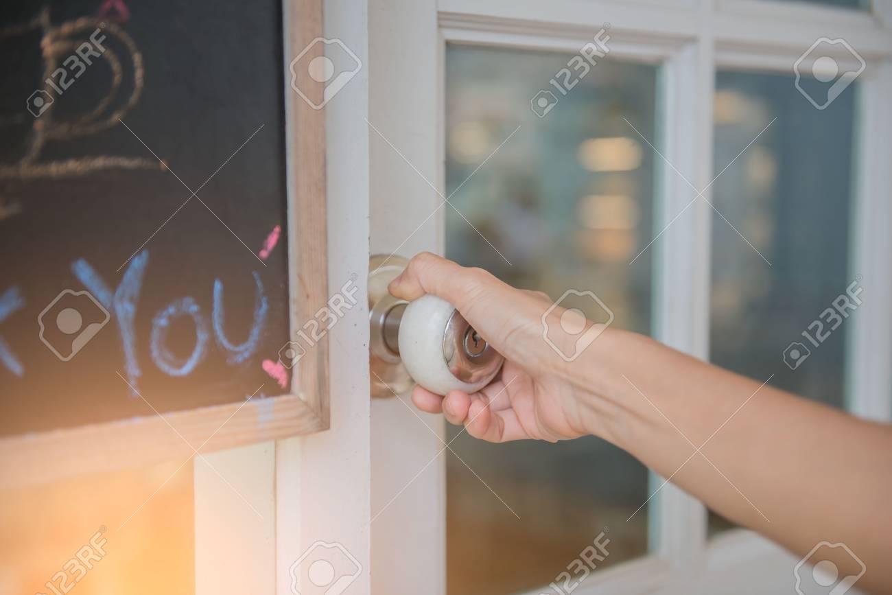 Hand Open The White Door Knob Or Opening The Door. Stock Photo   82819505