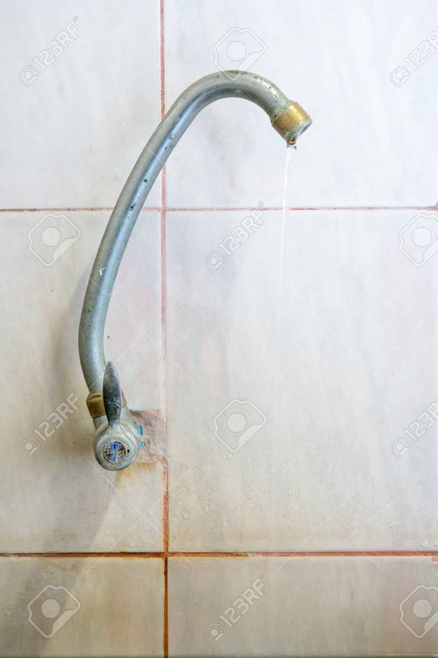 Old Faucet Leak In Dirty Old Bathroom Stock Photo, Picture And ...