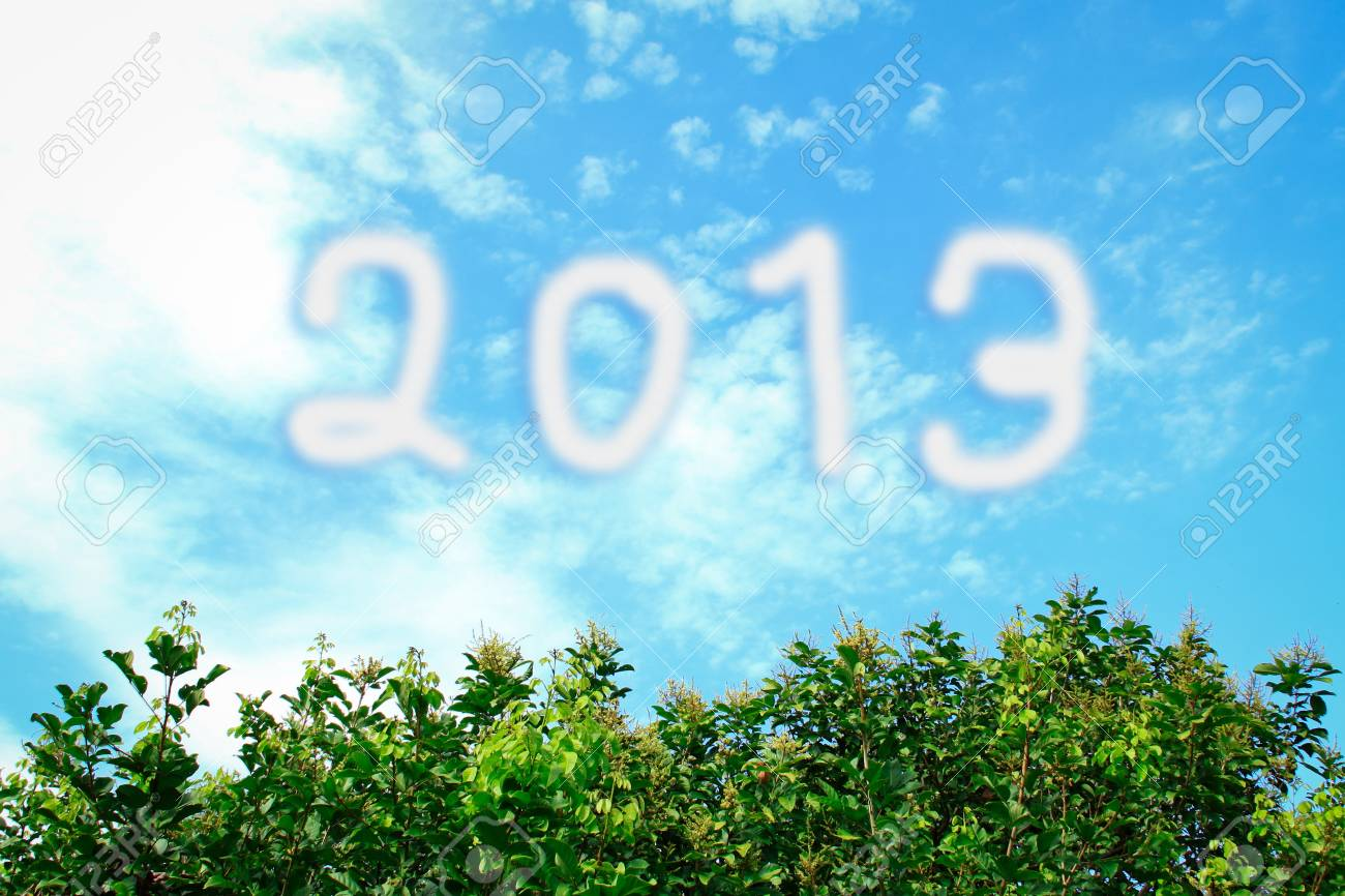 happy new year 2013 white cloud and blue sky, tree green Stock Photo - 17563457