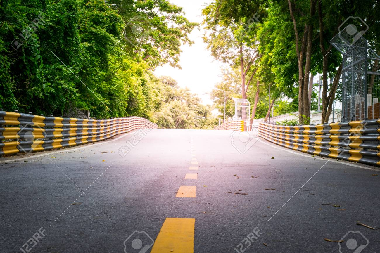 City Street Racetrack With A Roadside Trees Using Wallpaper Or