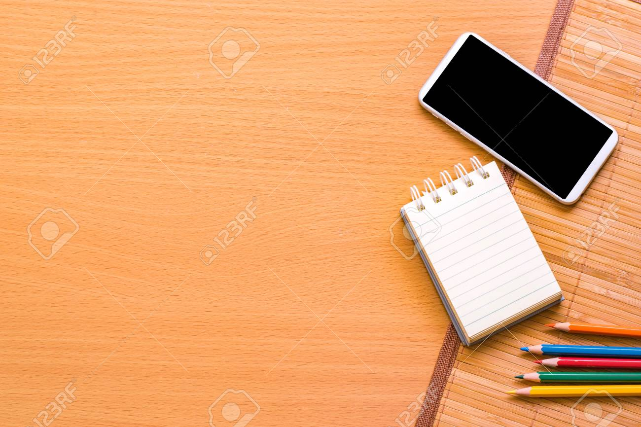 Notepad With Pencil And Smart Phone On Wood Board Background Using Stock Photo Picture And Royalty Free Image Image 85842067