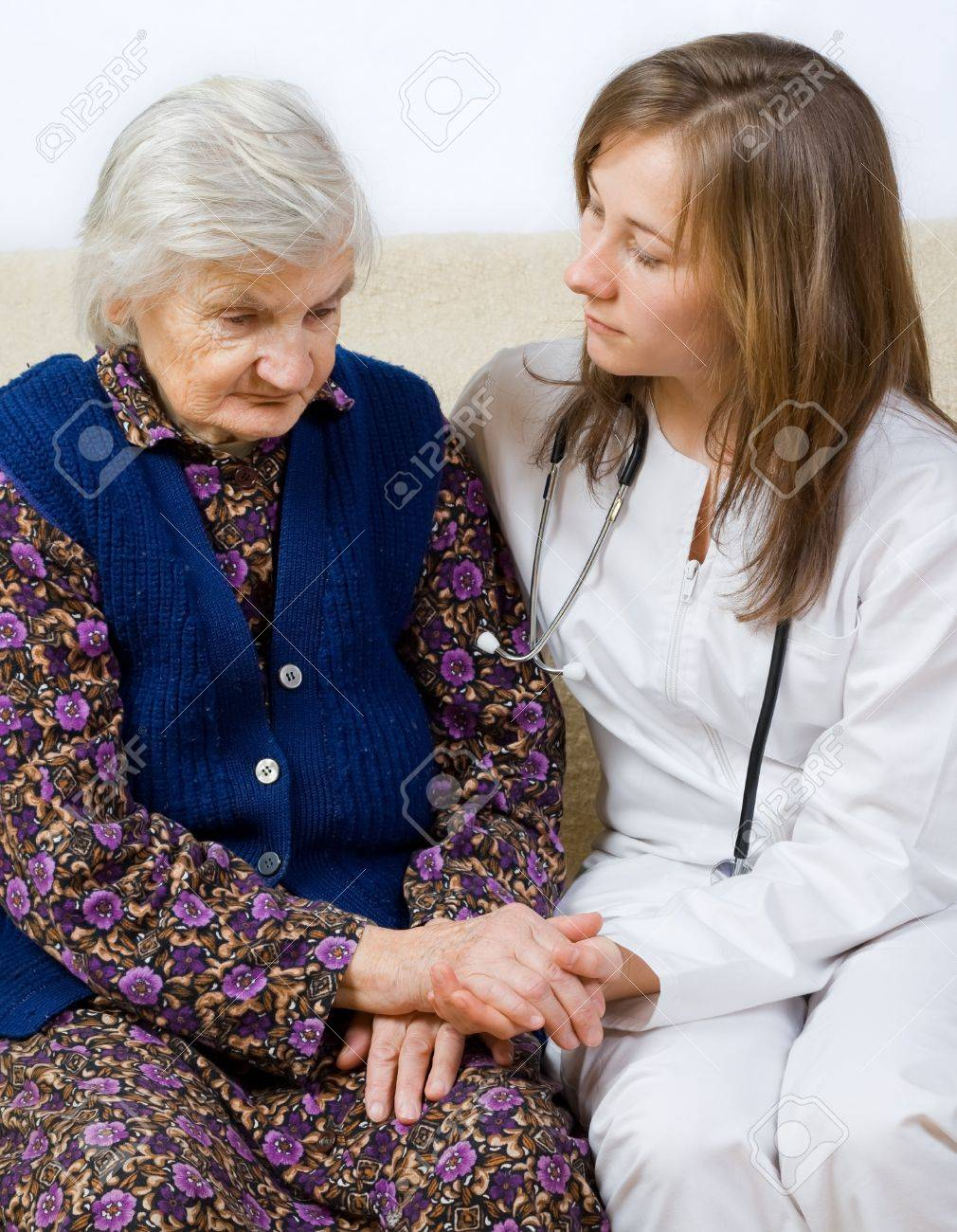 Old woman tells a story to the yung doctor Stock Photo - 17632112