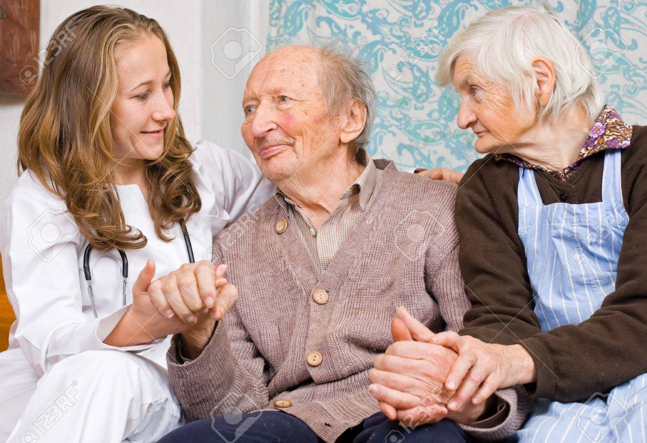 Old couple and the young sweet doctor Stock Photo - 17632117