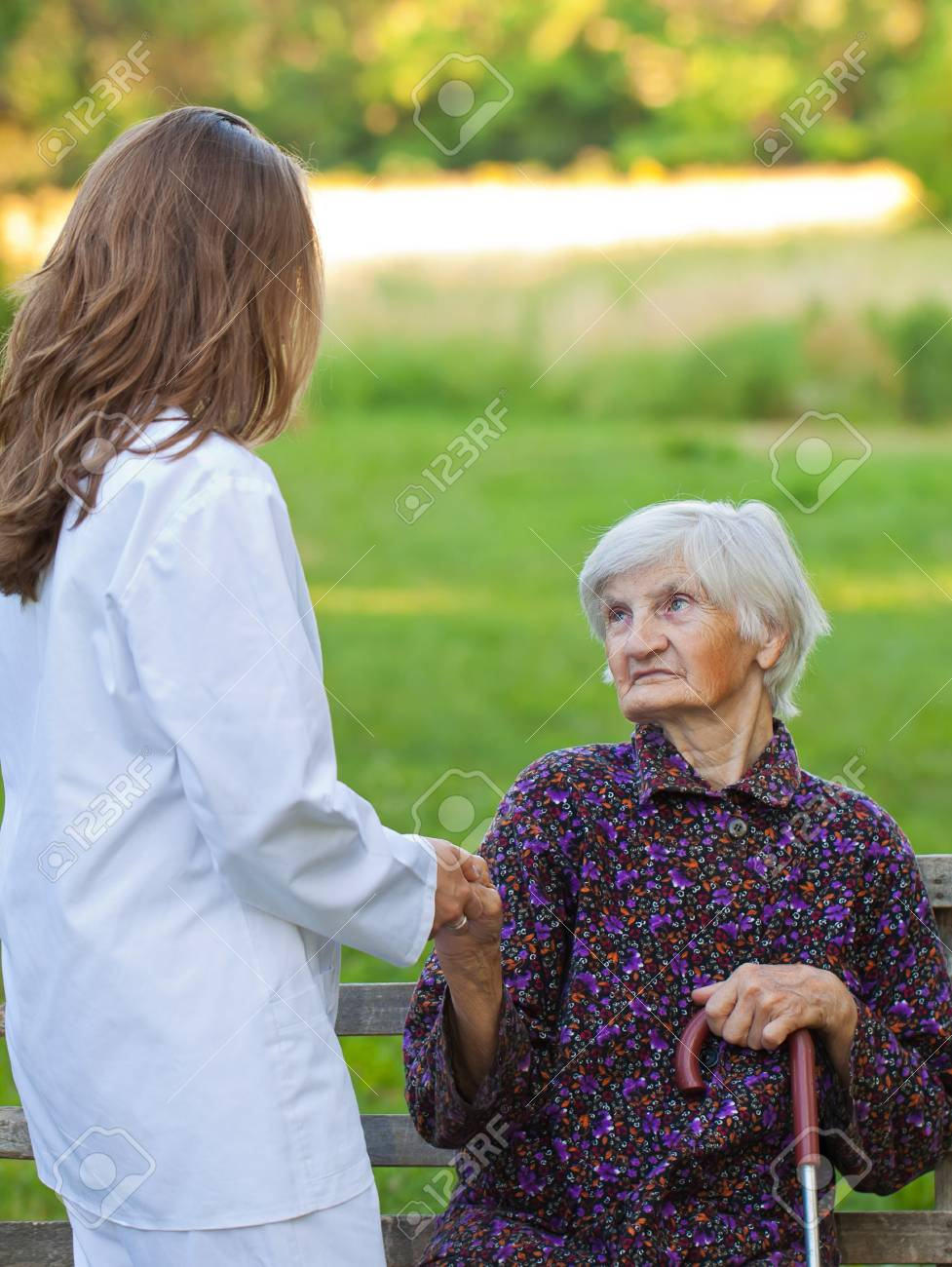 Elderly woman with the young sweet doctor Stock Photo - 18006932
