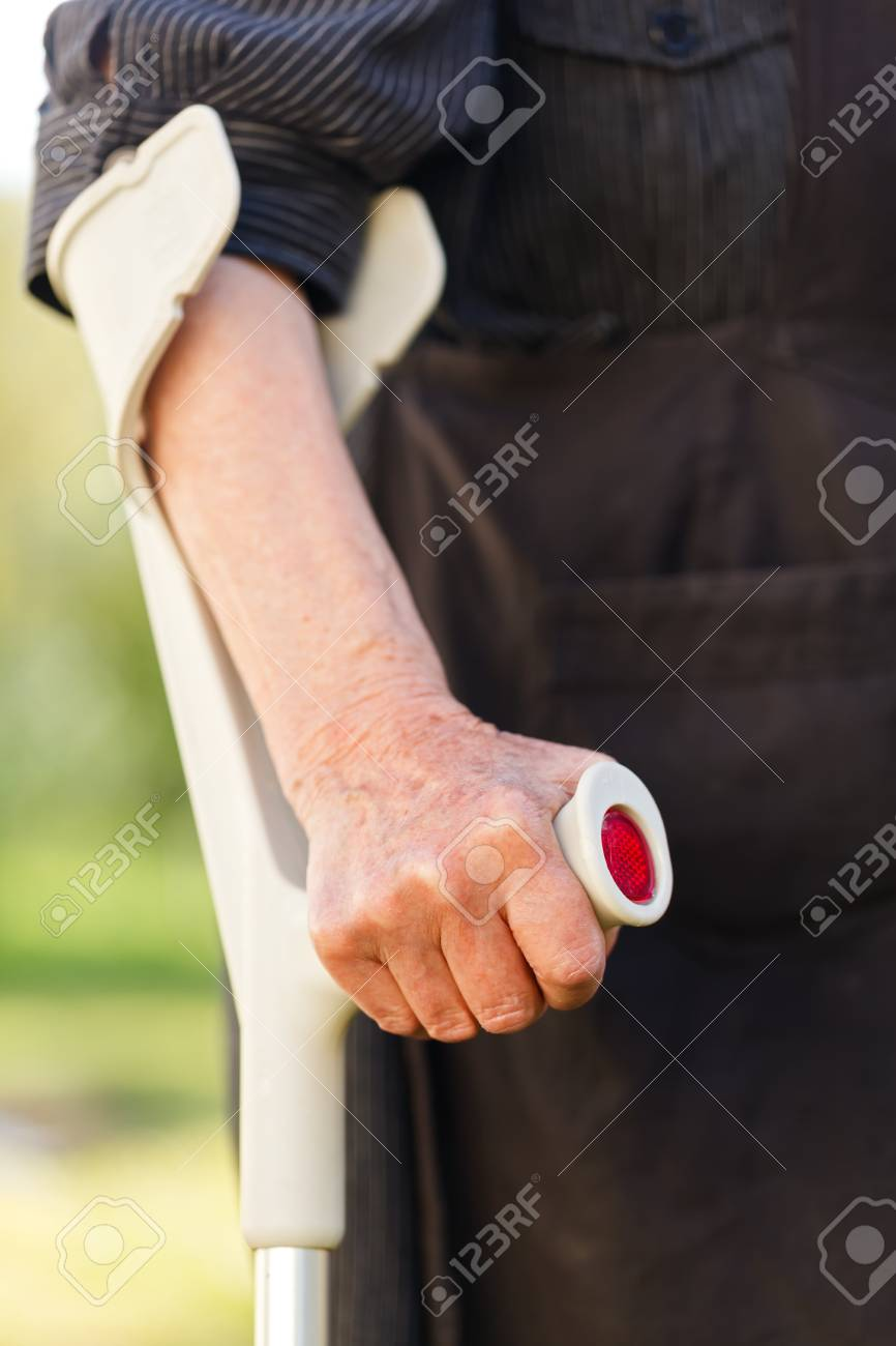 Elderly woman hands resting on the crutch Stock Photo - 19628891