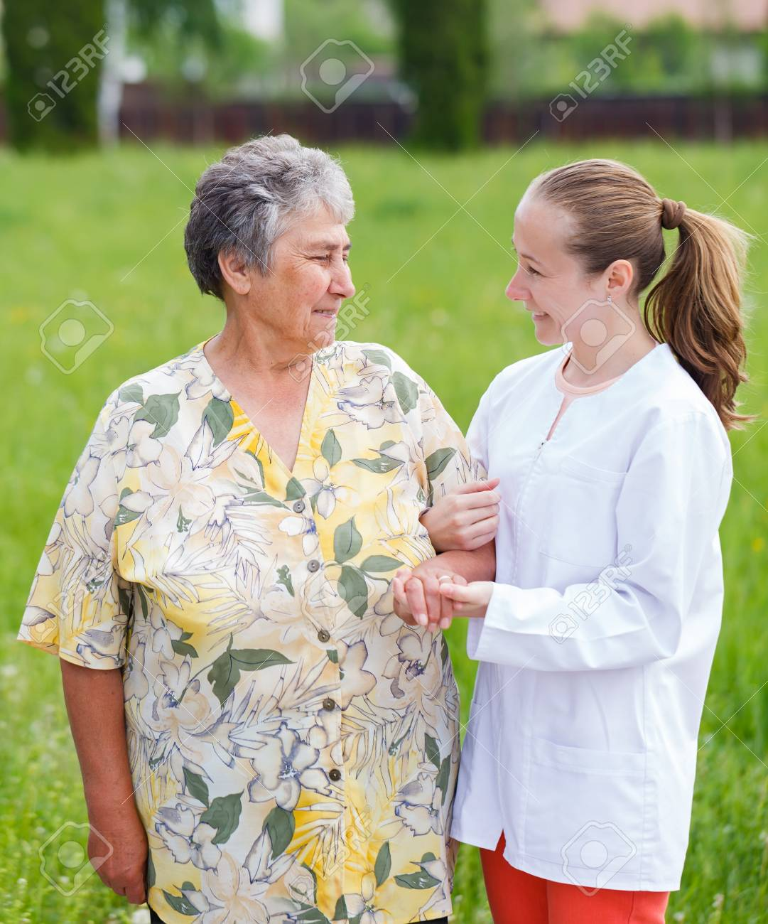 Elderly woman with her caretaker walking in the nature Stock Photo - 19666896