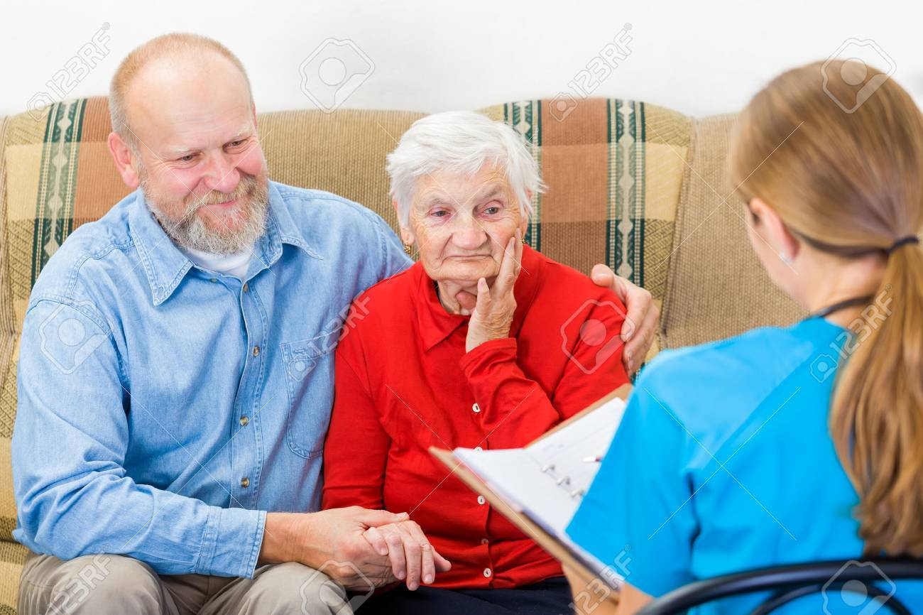 Photo of elderly woman tells a story for the doctor Standard-Bild - 36914775