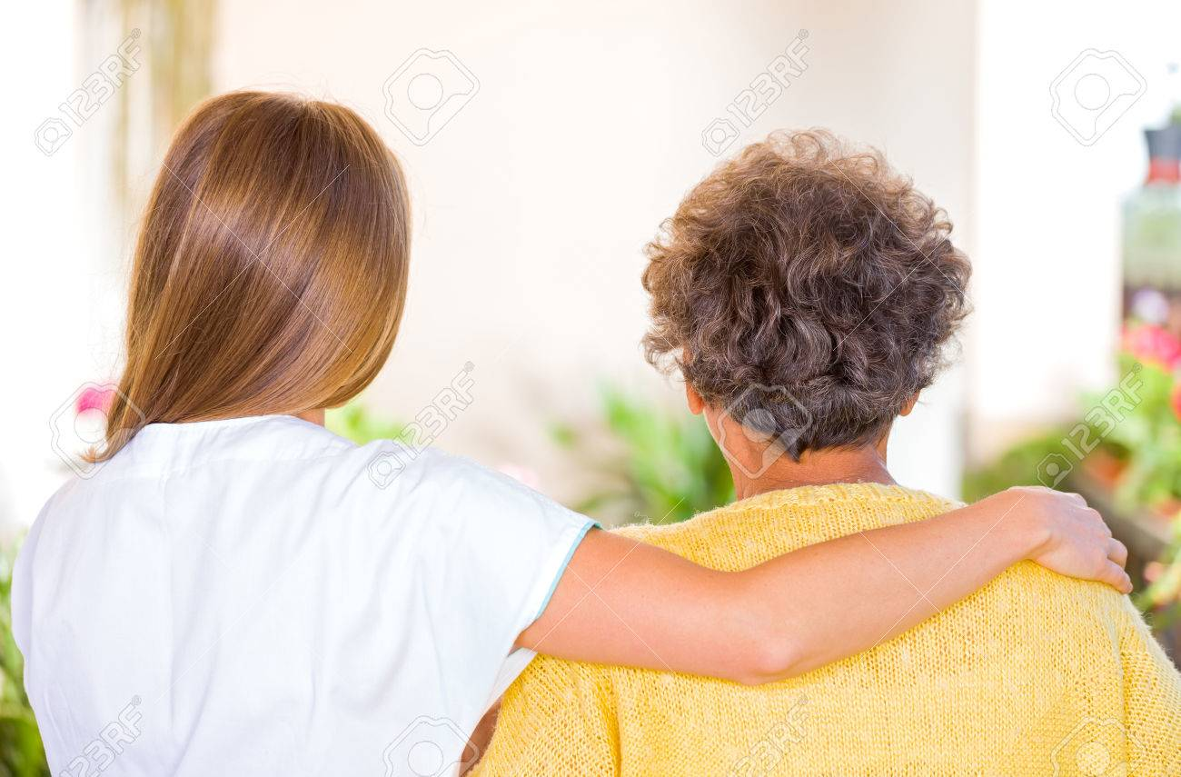 Photo of elderly woman with her caregiver Standard-Bild - 37013226