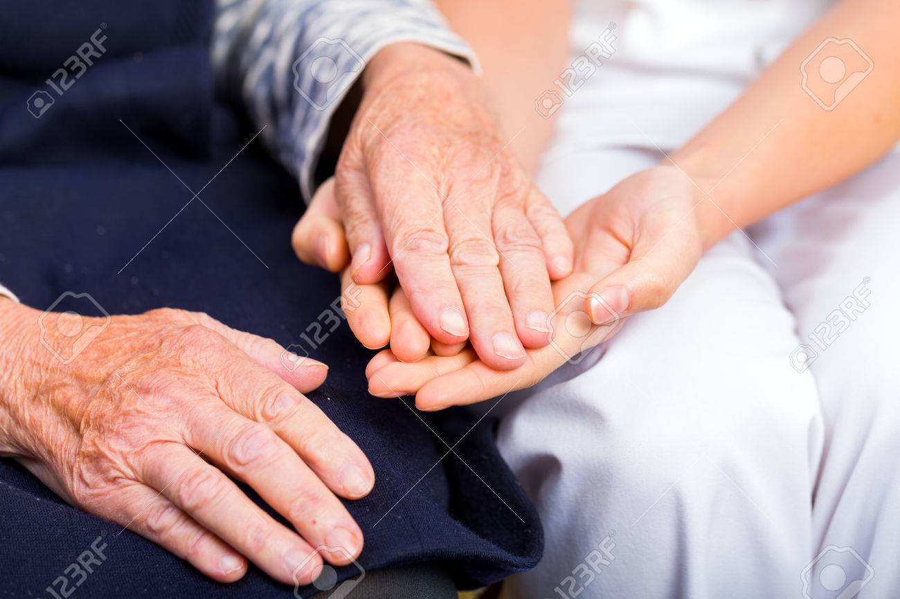 Young doctor giving helping hands for elderly woman Standard-Bild - 37013340